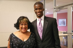 Winner for the HBCU Award for Best Male Athlete, JSU Anaso Jododwana (right) poses with JSU president Carolyn Meyers.