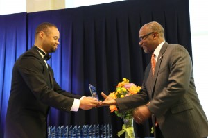 Jarret Carter, founder of the HBCU Digest and HBCU Awards, gives the award for Best Marching Band to Dowell Taylor, director of bands at JSU.