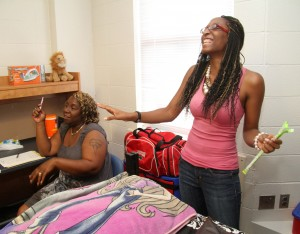 Lakendra Heck (right) of Jacksonville, Fla. jokes with her mother Katina Heck (left) as she moves into her new home.