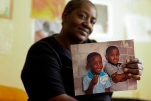 Thomascene Washington holds a photo of her grandsons who participate in the Washington Addition early childhood literacy program.