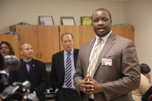 Blackburn Principal Justin Green thanks JSU officials for iPad donation and wireless initiative.
