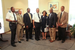 From l-r, L.J. Whitaker, Coach Omar Johnson, Wayne Goodwin, Deangelo Henderson, JSU President Carolyn Meyers, Sanford Winfield and Bob Owens of the Institutions of Higher Learning.