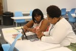 PRID committee members work on curriculum redesign in INNOVATE in the H.T. Sampson Library on JSU's campus.