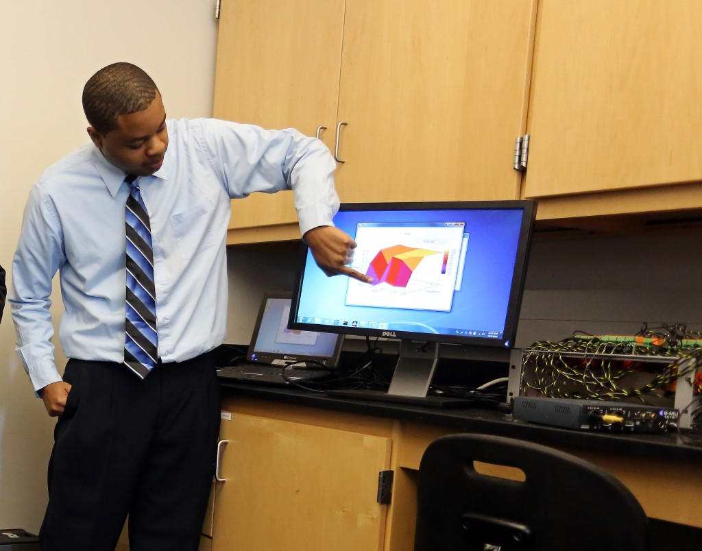 Joshua Turner, a senior engineering student, demonstrates an amplification measuring device. (Photo by Charles A. Smith, JSU)