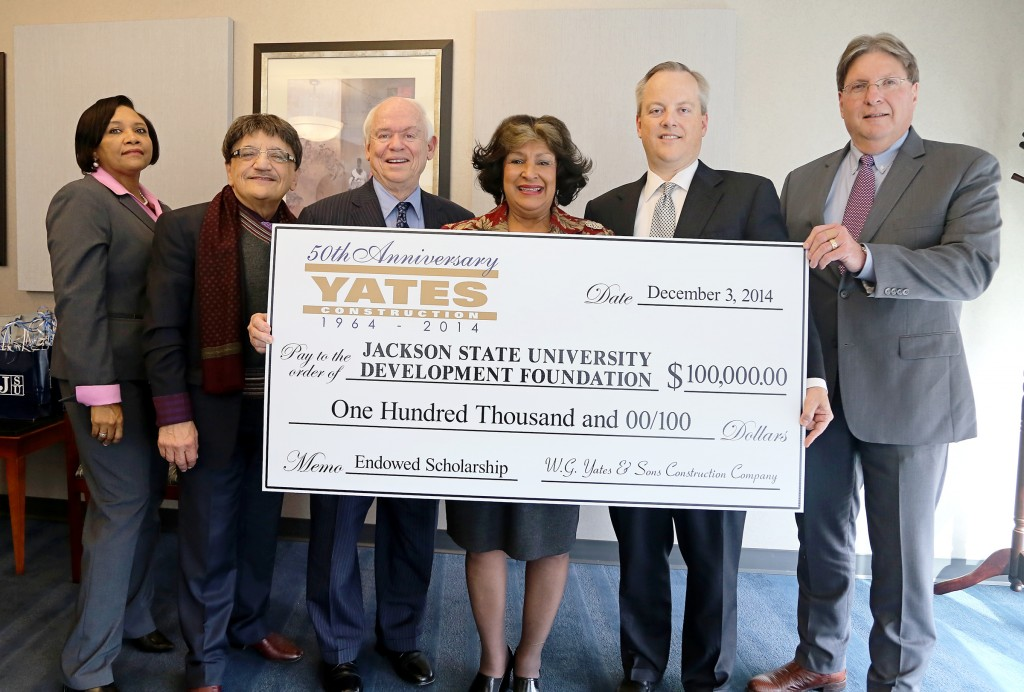 "Jackson State University President Carolyn W. Meyers (center) beams after executives from Yates Construction presented a gift to help establish an enduring partnership with the 50-year-old company. They envision an opportunity to create internships and future employment for graduates. Joining Meyers (from left) are: Constance Lawson, JSU development officer; Dr. Richard Alo, dean of the JSU College of Science Engineering and Technology; W.G. ""Bill"" Yates, chairman of Yates Construction; William Yates, president of Yates Construction; and Paul Musick, vice president of Yates Construction. (JSU photo by Charles Smith)."
