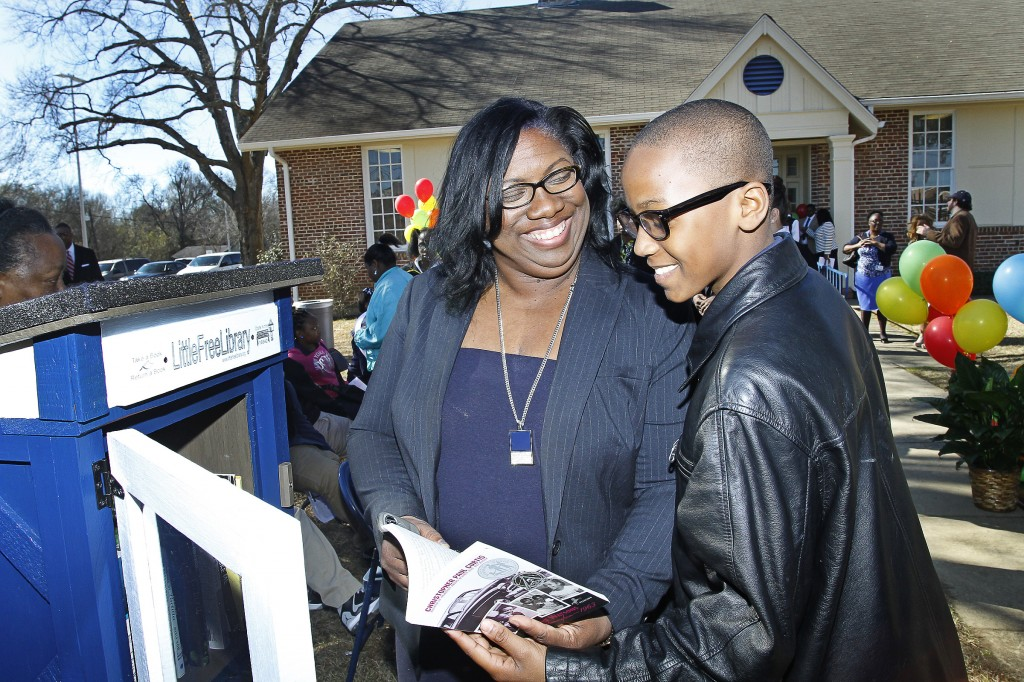 Dr. Kimberly Hilliard, executive director of JSU's Office of Community Engagement, shows Jaylin Thornton, 11, a Blackburn 6th grader, the Little Free Library at JSU's e-City Center, Tuesday, Jan. 27, 2015. (Photo by Charles A. Smith, JSU)