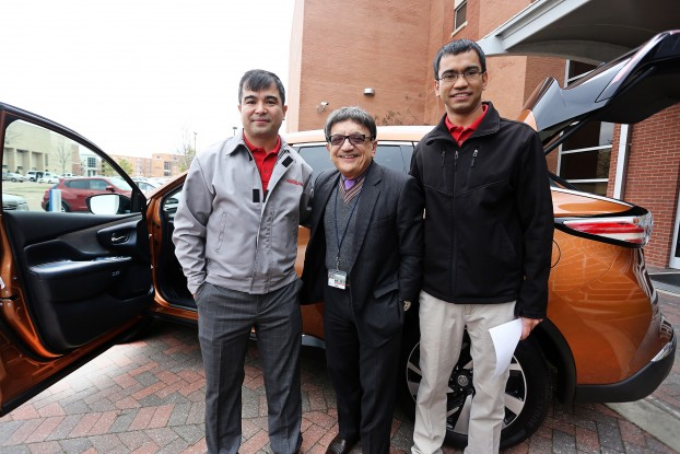 Jackson State University College of Science, Engineering and Technology (CSET) Dean Dr. Richard Alo (center) checks out the high-tech features of a 2015 Nissan Murano with Ahmad Faizi (left) a JSU grad and system engineer with Nissan, and his brother, Kahma Faizi, a senior in civil engineering who is a co-op student with Nissan, during Nissan Day at CSET. (Photo by Charles A. Smith, JSU)