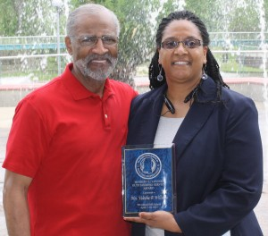 Velesha P. Williams, director of Metro Jackson Community Prevention Coalition (shown with Herbert L. Loving), has been awarded the Herbert L. Loving Award of Excellence.