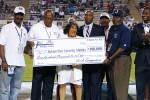 JSU President Carolyn W. Meyers accepts a contribution from the Tiger Fund. (Photo by Charles A. Smith/JSU)