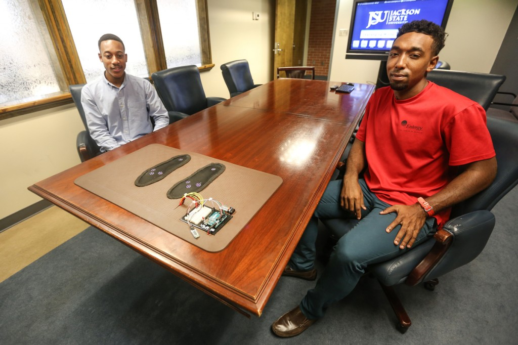 Smart Mat3: Chevan Baker, left, a senior computer engineering major from Kansas City, Mo., and Jann Butler, a senior computer engineering major from Pascagoula, Miss., were among four who helped develop a product called the smart mat to determine the foot temperature of diabetics. (Photo by Charles A. Smith/JSU)