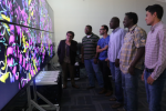 With the program's doctoral students, Dr. Richard A. Aló, dean of JSU's College of Science, Engineering and Technology, showcases a Big Data visualization wall of high-resolution images. (Photo by Charles A. Smith/JSU)