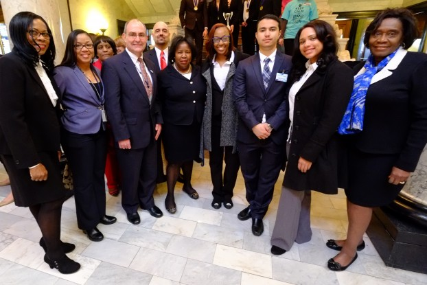 Members of iTECHealth Systems, (beginning fourth from right) Kaylin Kinchion, Omar Khattab and Kenya Gilkey, are congratulated by JSU administrators and staff on their business concept for reducing obesity. Pictured with the students are: (from left) Dr. Marinelle Payton, Almesha Campbell, Dr. Dorothy Browne, Dr. Kenneth Russ, Dr. Ramin Maysami, Dr. Loretta Moore and Dr. Evelyn Leggette.