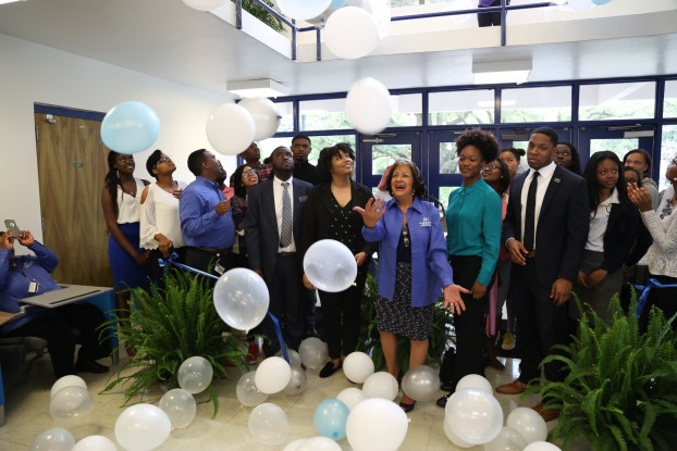 JSU President Carolyn W. Meyers celebrates with students during a balloon shower in observance of upgrades to classroom infrastructure in the Charles F. Moore Building. (Photo by Charles A. Smith/JSU)
