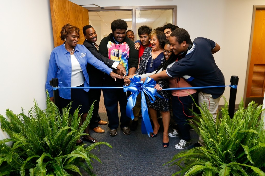 Jackson State University President Carolyn W. Meyers is assisted by students and staff during a ribbon-cutting ceremony Thursday for the new ENGAGE center, for 3-D printing and imaging, in the basement of the H.T. Sampson Library. (Photo by Anissa Hidouk/JSU)