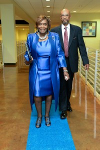 Beaming magnificently, Dr. Evelyn J. Leggette, senior vice president and provost, strolls down the blue carpet with Dr. Thomas Calhoun, associate vice president for Academic Affairs. (Photo by Darek Ashley/JSU)