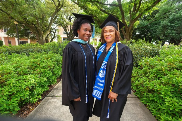 Aisha J. Nash (left) will receive her master of arts in teaching degree the same weekend that her mother, Jackie A. Nash will earn her bachelor of business administration in management degree from JSU. (Photo by Charles A. Smith/JSU)