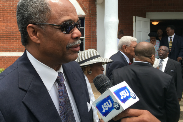 Roscoe Word, a former JSU and NFL player discusses the legacy of Hill at First New Hope Baptist Church, where mourners gathered to remember Hill.