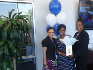 Nicole Gholar-Harris, center, in Title III, earned second place in the contest. She received gas cards totaling $125. She's congratulated by XXXXXX, xxxxxxxx, and Gwen Caples, director of the JSU Welcome Center.