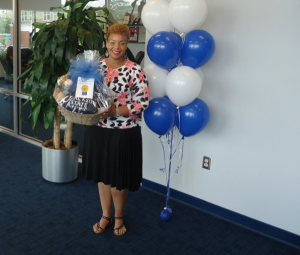 Third-place winner Kelli Olive in the School of Lifelong Learning received a JSU-themed gift basket from the JSU Bookstore.