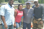 Eric Gulledge, left, Taimei Harris, Dr. Timothy Turner and Willis Lyons at the Gulf Coast Research Laboratory in Ocean Springs, Miss.