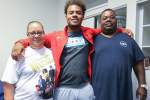 Urban Prep Academy graduate, Michael Taylor II says goodbye to his parents before they return to Chicago
