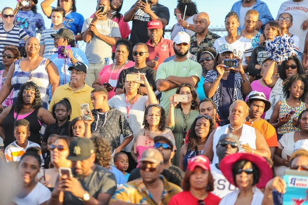 A crowd of spectators stands to their feet as JSU struts onto the field of Pearson Community Center.  (Photo by Charles A. Smith/JSU)