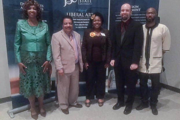 Faculty members in JSU's College of Liberal Arts celebrate their colleague's new distinction as Teacher of the Year. Appearing with honoree and associate professor of history Dr. Mark Bernhardt, second from right, are Dr. Bessie House-Soremekun, left, associate dean in the College of Liberal Arts; Dr. Mario Azevedo, dean of the College of Liberal Arts; Dr. Preselfannie Whitfield-McDaniels, associate professor of English; Bernhardt; and Dr. Rico Chapman, interim chair of the Department of History and Philosophy. (Photo by L.A. Warren)