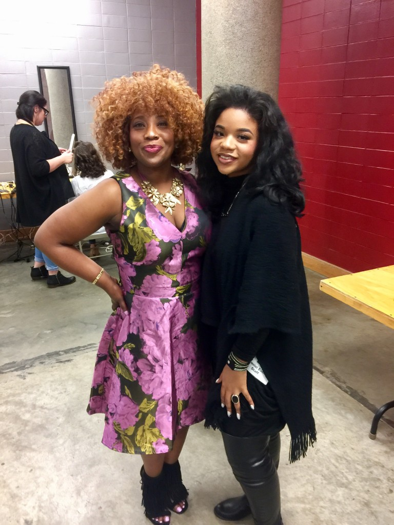 Carter-Simmers, left, joins India Jones, a makeup artist representing Belk department store. Carter-Simmers participated in the 2016 Mistletoe Marketplace fashion show on Nov. 4 inside the Mississippi Trademark, which was presented by the Junior League of Jackson. (Photo By Dwain Doty/WJSU)