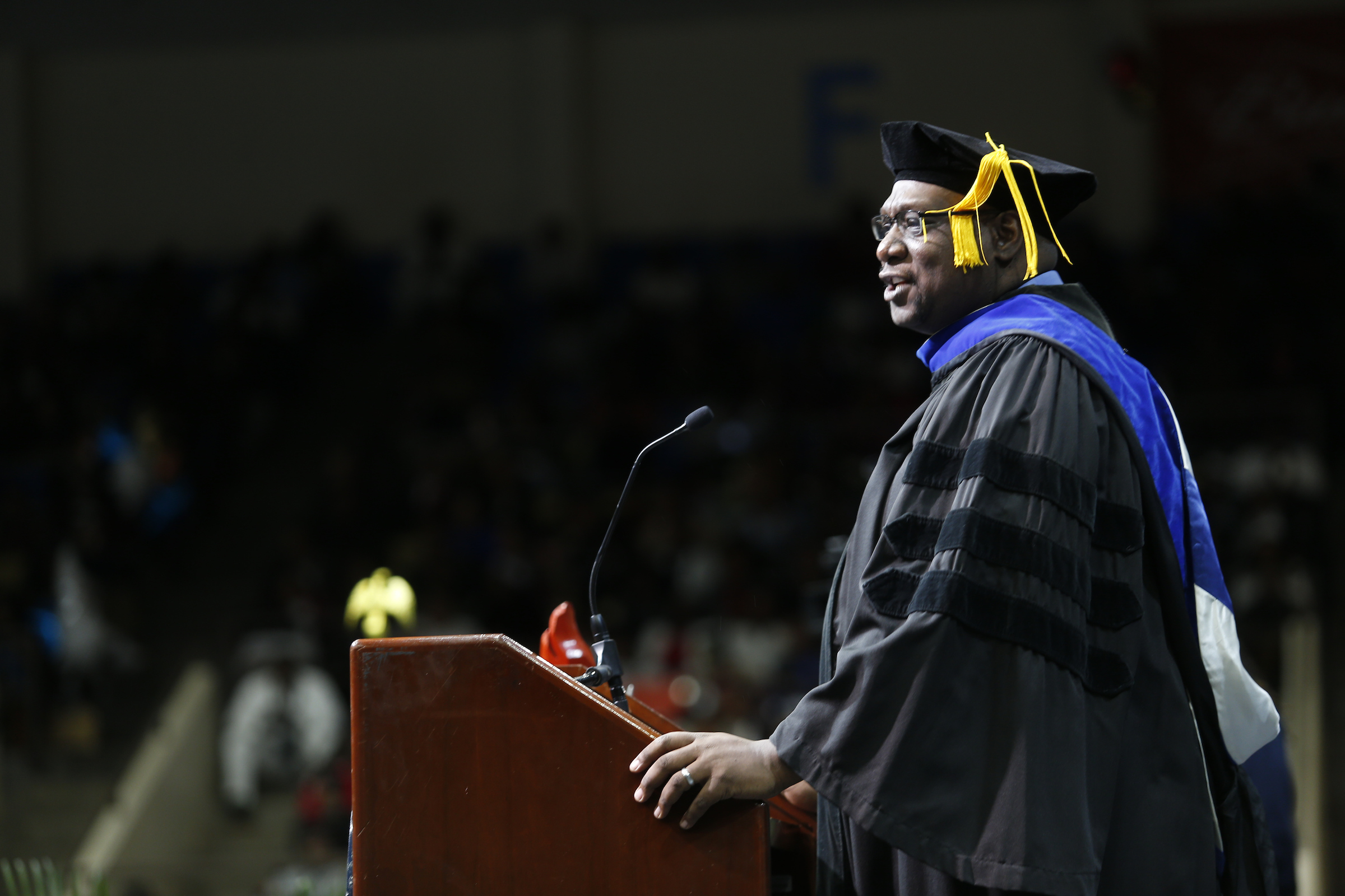 Keynote speaker Dr. Mark Henderson, dean of the JSU speech and theater department, gave a moving and melodramatic speech that ended with the graduates on their feet. (Photo by Charles A. Smith/JSU)