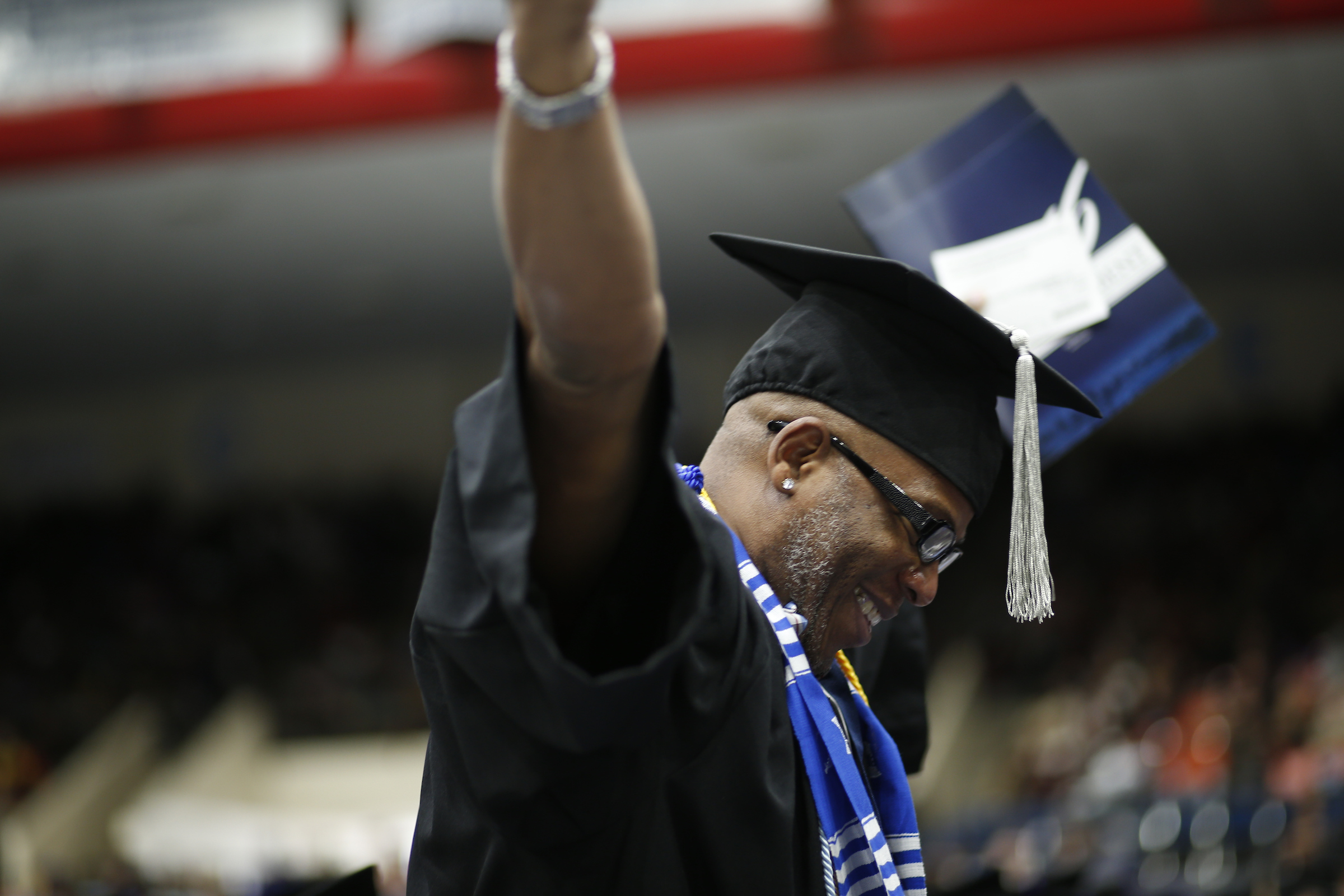 Keith Kennard cannot contain his elation over receiving his degree putting an end to a 6 hour commute from Atlanta to Jackson over a 2-year time frame. (Photo by Charles A. Smith/JSU)