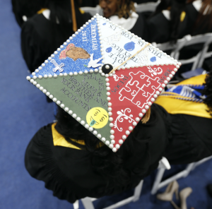 A graduate finds a unique way to thank her family for contributing to her degree. (Photo by Charles A. Smith/JSU)