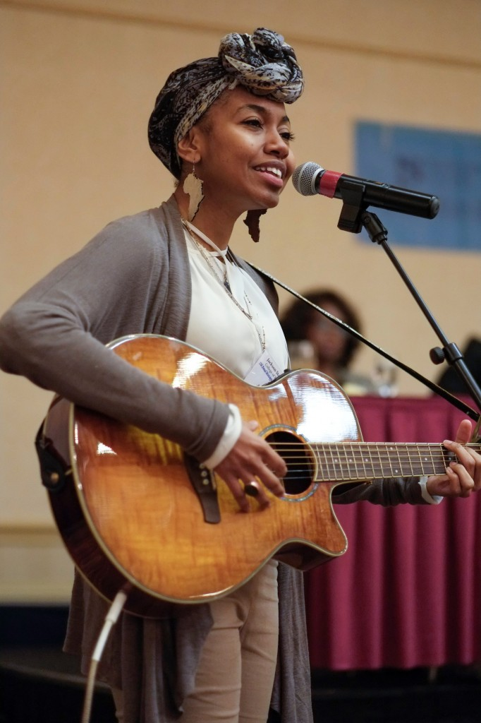 Jalise Haney, a master of social work student, delivers a soul-stirring performance during the conference.