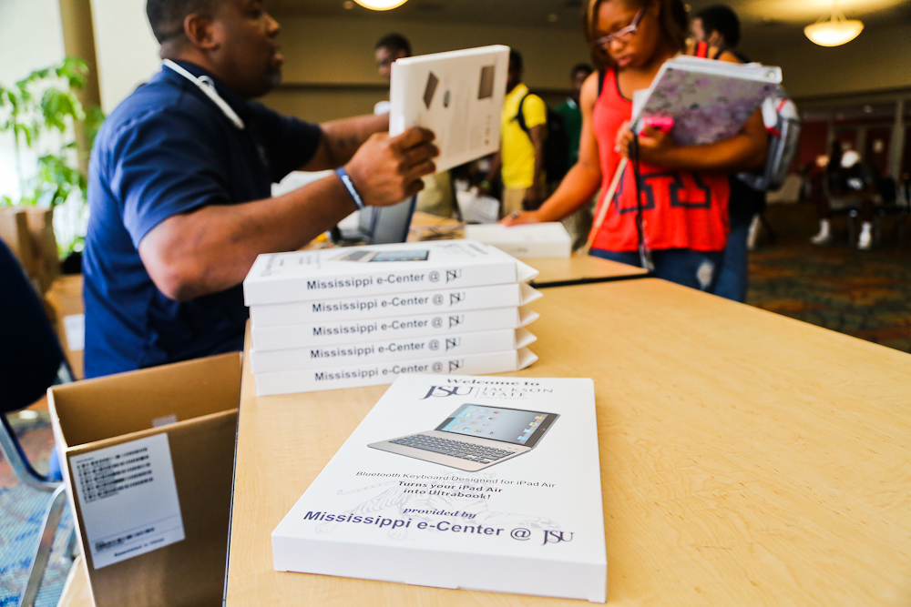 More than 5,000 iPads have been distributed since the giveaway initiative began. In addition to the devices, the kits include a Bluetooth keyboard, a case and productivity apps. (Photo by Charles A. Smith.)