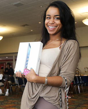 "One happy ""customer"" proudly displays her coveted prize. (Photo by Charles A. Smith/JSU)"