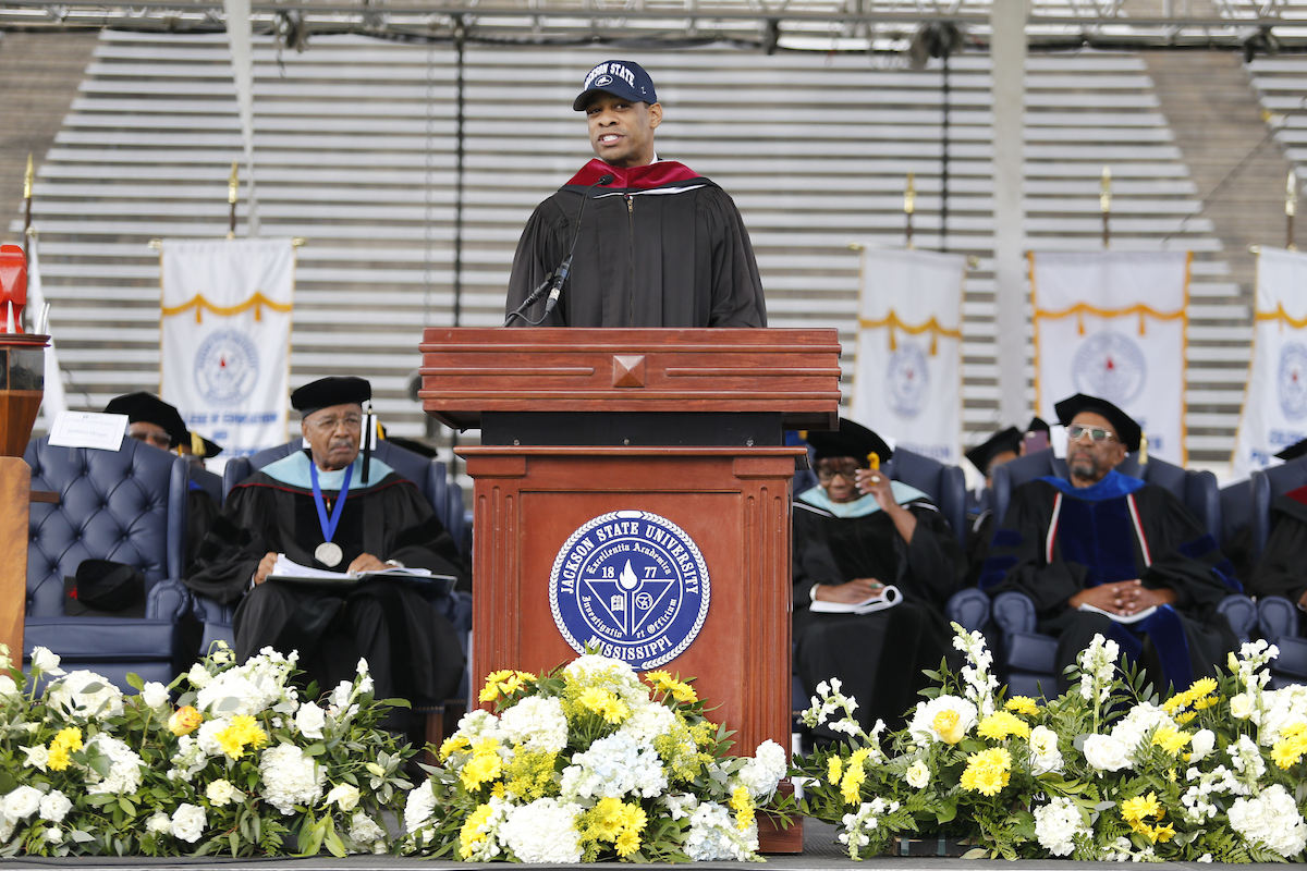 Undergraduate commencement speaker DeMarco Morgan, a national CBS News correspondent, tells his compelling story about how he rose to one of the top broadcasting networks from humble beginnings. He credits Jackson State for taking a chance on him when other institutions of higher learning denied him. He spoke Saturday to an audience of thousands in the Mississippi Veterans Memorial Stadium (Photo by Charles A. Smith/JSU)