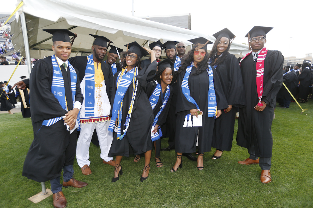 Graduates prepare for the 2017 undergraduate commencement ceremony, with nearly 700 receiving bachelor's degrees in various disciplines. (Photo by Charles A. Smith/JSU)