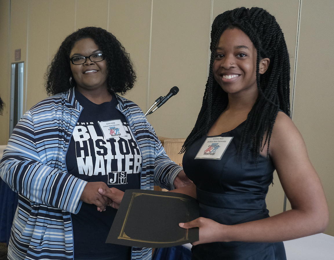 Dr. Helen Crump, associate English professor in the Department of English and Modern Foreign Languages and co-coordinator of the fest presents JSU student Brittany Keys with the Margaret Walker Award (Charles A. Smith/JSU)