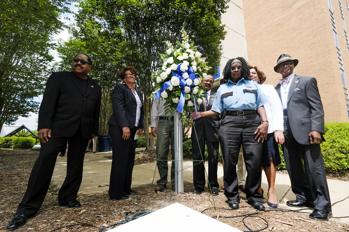 A number of people affected by the tragedy returned to pay homage to those who lost their lives or were injured. A wreath was placed outside Alexander Residence Hall, a building struck by a barrage of gunfire. (Photo by Charles A. Smith/JSU)