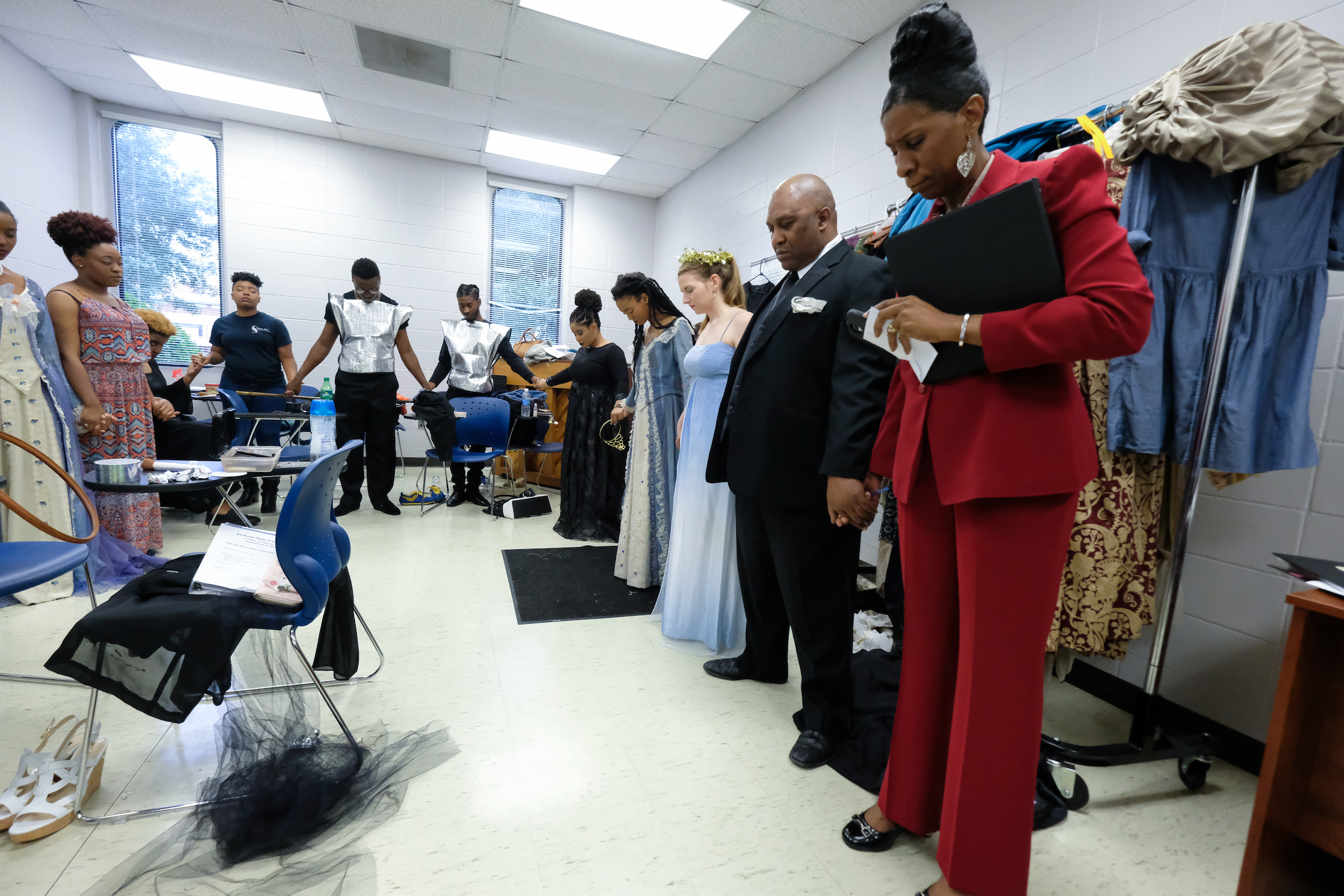 Dr. Phyllis Lewis Hale, director of the music opera musical theatre ensemble; Jerry Smith, piano accompanist and her students gather in a word of prayer before blazing the stage. (Charles A. Smith/JSU)