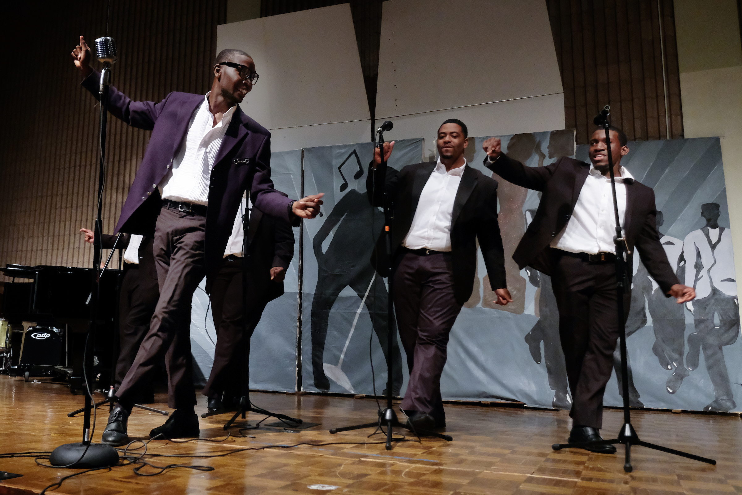 "The Temptations (Scott, Hughes, Middleton, Brown and Hope) show their leg work in ""Ain't Too Proud to Beg."" (Charles A. Smith/JSU)"