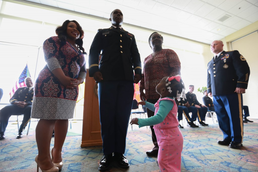 Getting support from family, 2nd Timothy O. Mathews Jr., earns his bars. The native of Cary, Miss., received his bachelor of science degree in recreation administration in JSU's College of Health, Physical Education and Recreation. (Photo by Kentrice S. Rush/JSU)