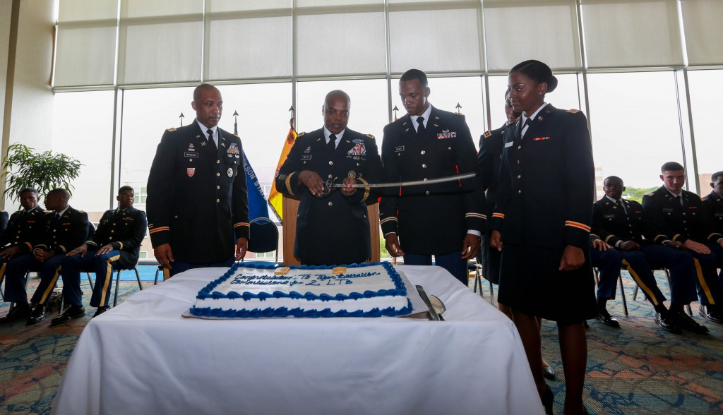 Brookins and Twitty join newly commissioned second lieutenants for the congratulatory cake-cutting ceremony. (Photo by Kentrice S. Rush/JSU)