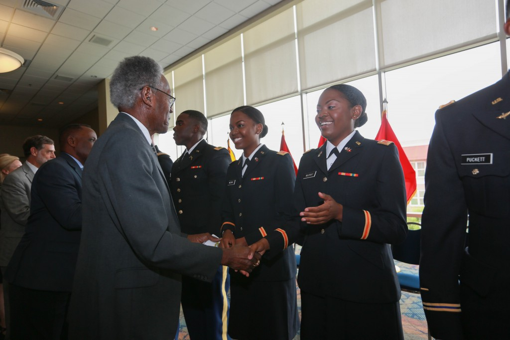 JSU president emeritus Dr. James A. Peoples Jr. congratulates identical twins Diamond and Sapphire McCray, both of Magnolia, Miss. On Saturday, 2nd Lt. Diamond McCray earned her bachelor of science degree in political science in JSU's College of Liberal Art.  Second Lt. Sapphire McCray earned her bachelor of science degree in biology/pre-medicine in JSU's College of Science, Engineering and Technology. Peoples, as the sixth president of JSU, founded the Army ROTC at JSU 50 years ago. (Photo by Kentrice S. Rush/JSU)