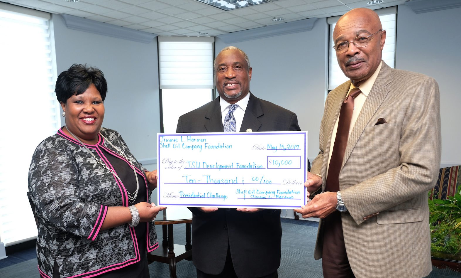 "Jimmie Jones, a 1975 alum at Jackson State University, presents a gift to the JSU Development Foundation with Sandra Hodge, interim vice president of JSU's Institutional Advancement and interim JSU President Rod Paige. Harmon said, ""If it weren't for Jackson State, I would not have been working for Shell Oil Co. … Hopefully, this gift will help close the gap for what Dr. Paige is trying to do."" Photo by Charles A. Smith/JSU."