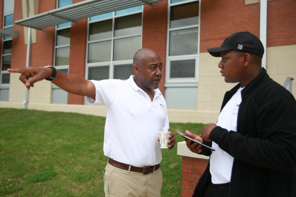 Ephraim Hill, an eighth-grade student from Blackburn Middle School, plans a flight path for a drone competition with instruction from Dr. Kamal S. Ali, chair of JSU's Department of Industrial Systems and Technology. (Photo by Kentrice S. Rush/JSU)