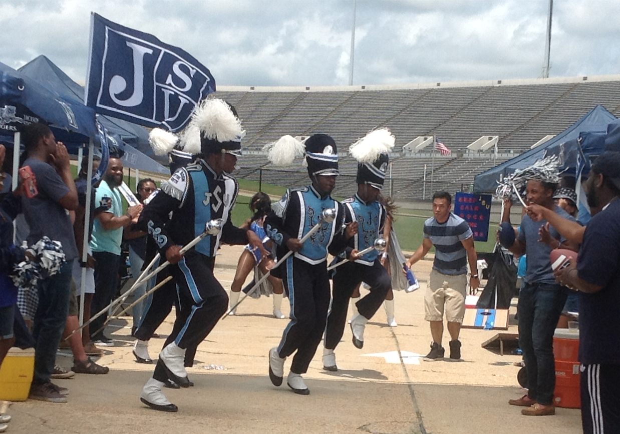 J-5 drum majors strut during a simulated tailgating scene for a C Spire commercial that will begin airing in August ahead of football season. (Photo by L.A. Warren/JSU)
