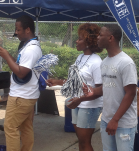 JSU extras Nicholas Armstrong, left, Brittany Edwards and Jamarion Wright participate in the tailgate production. (Photo by L.A. Warren/JSU)