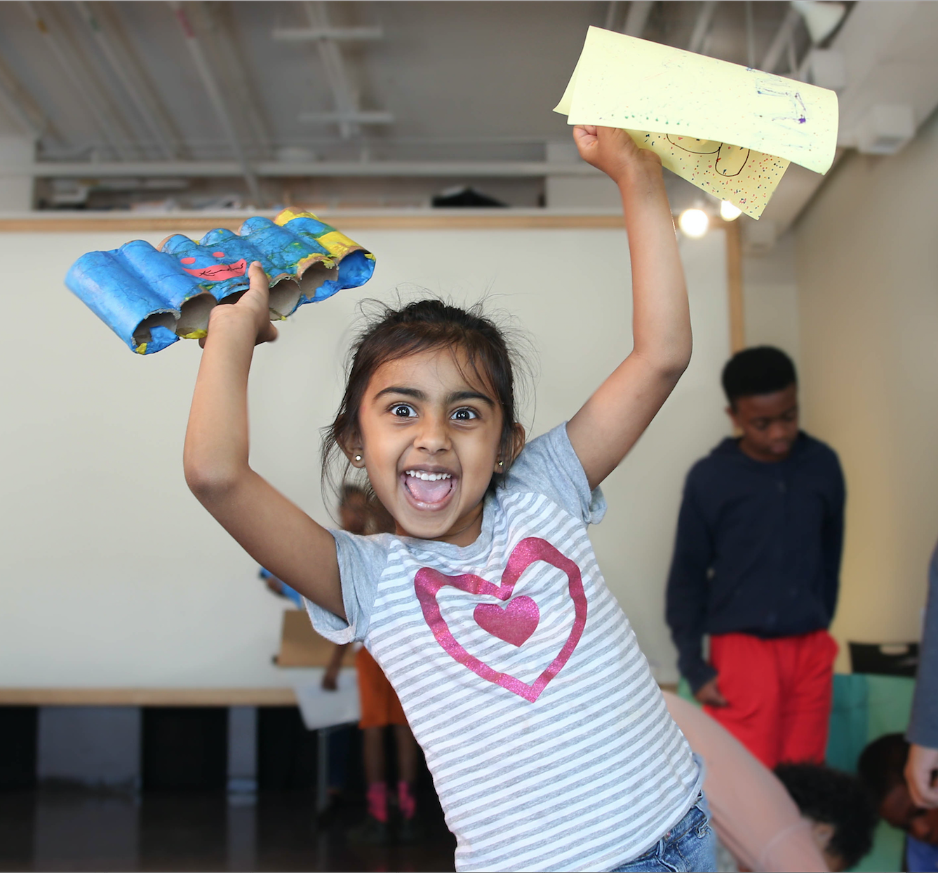 One adorable student shows her enthusiam after Mason's pop-art class. (Photo by Kentrice S. Rush/JSU)