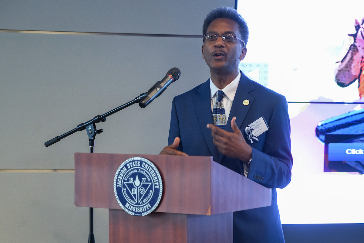 Dr. Sam Mozee, associate director of the Mississippi Urban Research Center at Jackson State University, touts the importance of showcasing the people, programs, partnerships and projects inside the JSU Downtown Campus, 101 Capitol Street. Dozens of JSU constituents and stakeholders joined JSU administrators, faculty and staff Wednesday to celebrate the facility's excellence. (Photo by Charles A. Smith/JSU)