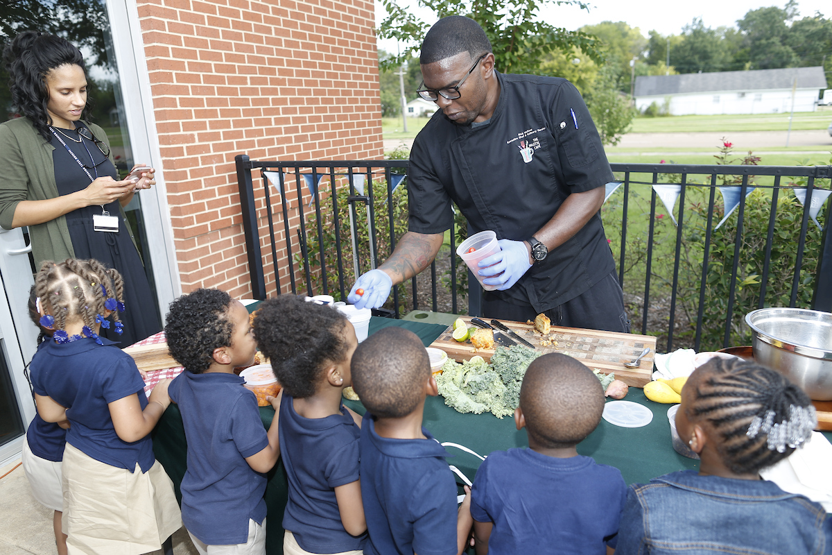 Pupils from JSU's Lottie W. Thornton Early Childcare Center in the College of Education sample fresh vegetables provided by Nick Wallace, executive chef and curator of Palette Café and owner of Nick Wallace Culinary. (Photo by Charles A. Smith/JSU)